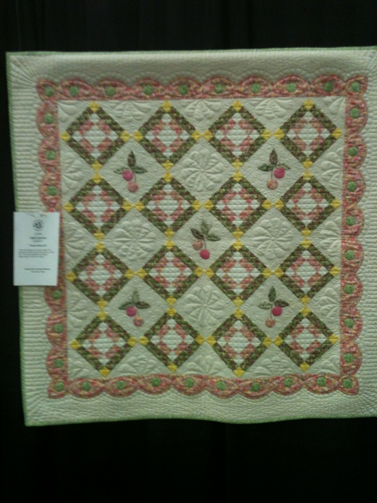 This was a sweet pink, green and yellow crib quilt with appliqued cherries